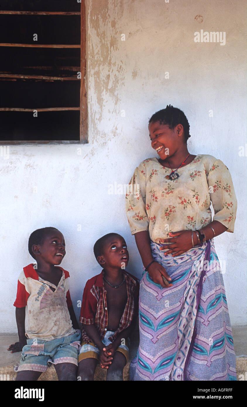 Friendly local woman with her children Chole island Mafia south of Zanzibar Tanzania East Africa - Stock Image