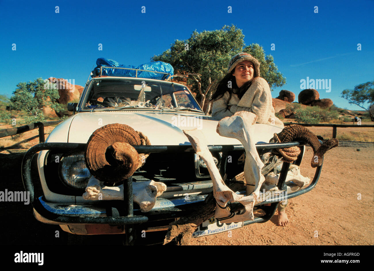 woman with decorated car, Northern Territory, Australia - Stock Image