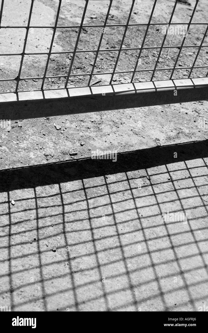 Wire Fence Shadow - Stock Image