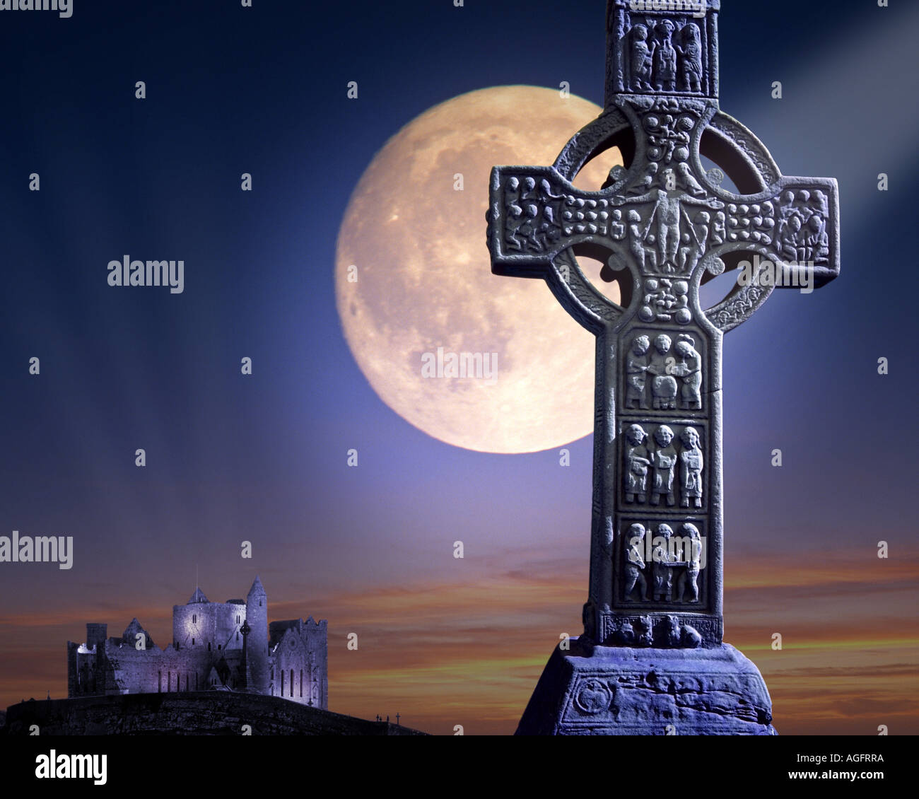 IRISH CONCEPT:  Celtic Muiredach's Cross and Rock of Cashel with moon - Stock Image