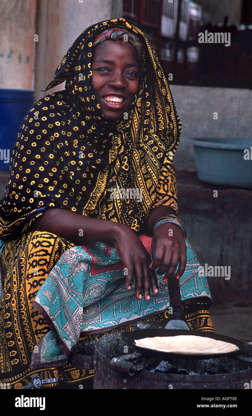 Local woman making and selling Chapatis Chole Island Mafia island Mafia lies between Zanzibar and Mozambique Tanzania E Africa - Stock Image