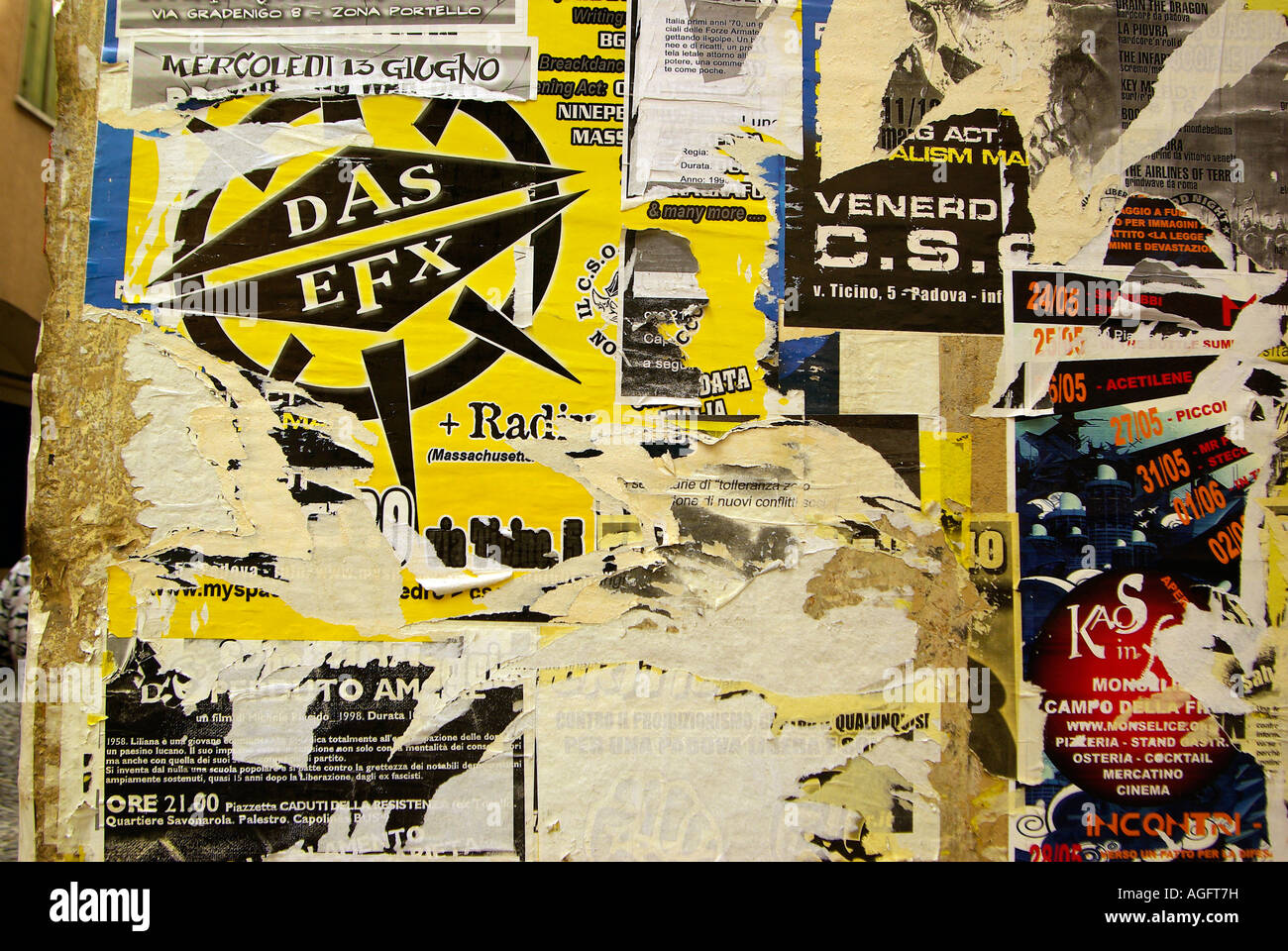 Street Art: Student protest posters interspersed with dance clubs Padua Italy - Stock Image
