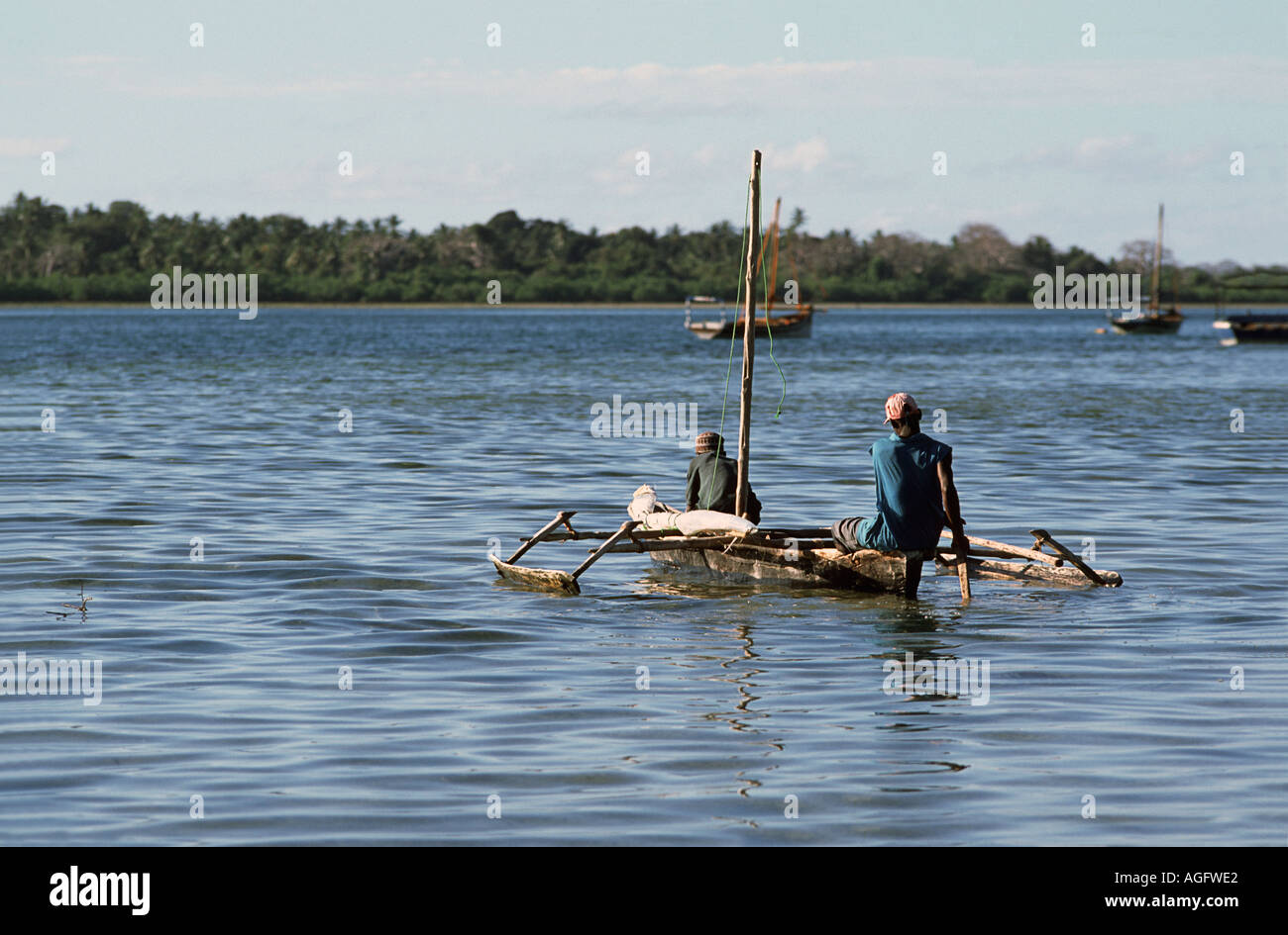 Fishermen set in their outrigger canoe into the straits between Mafia and Chole island Mafia lies in the Indian Ocean TANZANIA - Stock Image