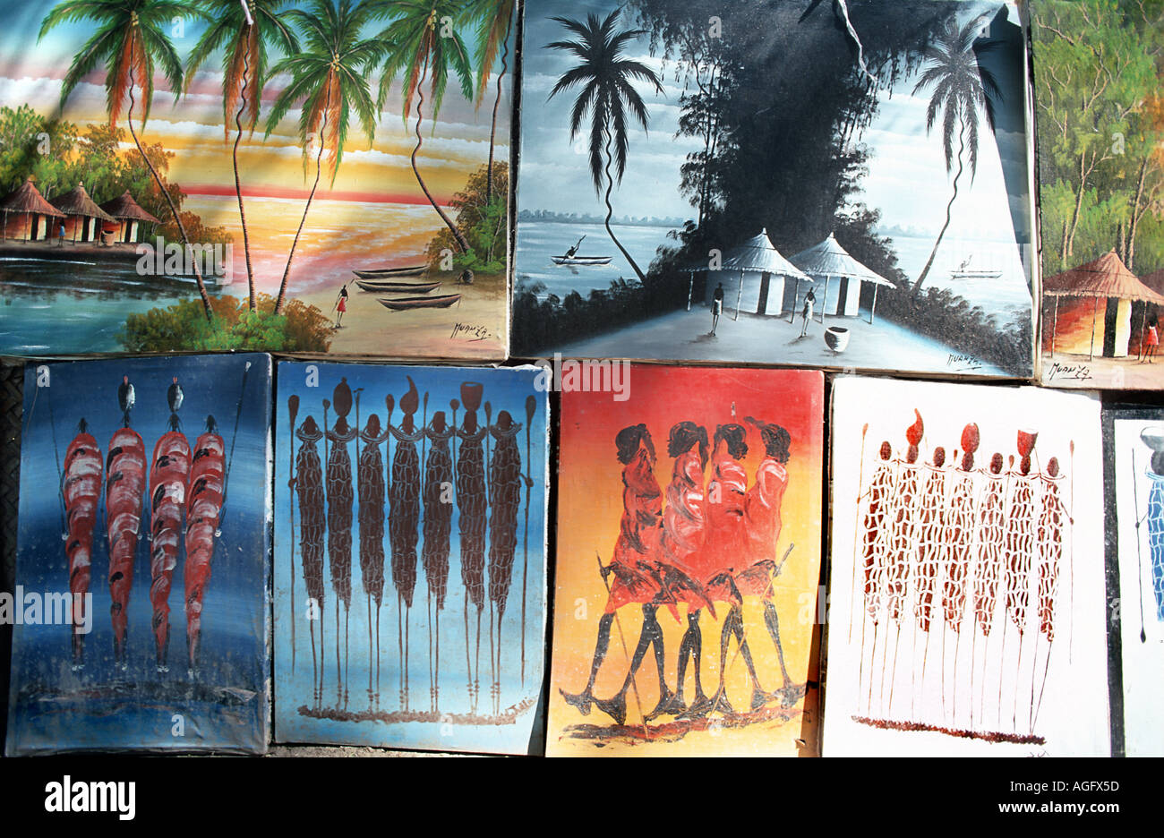 Selection of Tinga Tinga and other painting styles for sale in Nungwi Unguja Zanzibar Tanzania East Africa - Stock Image