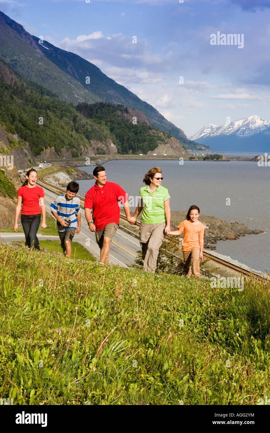 Family of Day Hikers Enjoy Scenery from Ridge AK SC Turnagain Arm Chugach SP Summer - Stock Image