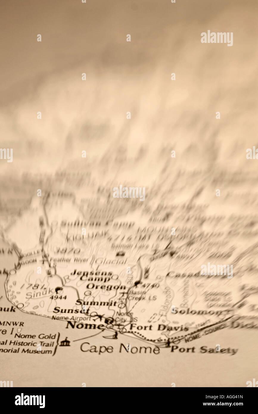 Closeup of compass laying on State of Alaska Nome Map Still Life Alaska w w o Sepia - Stock Image