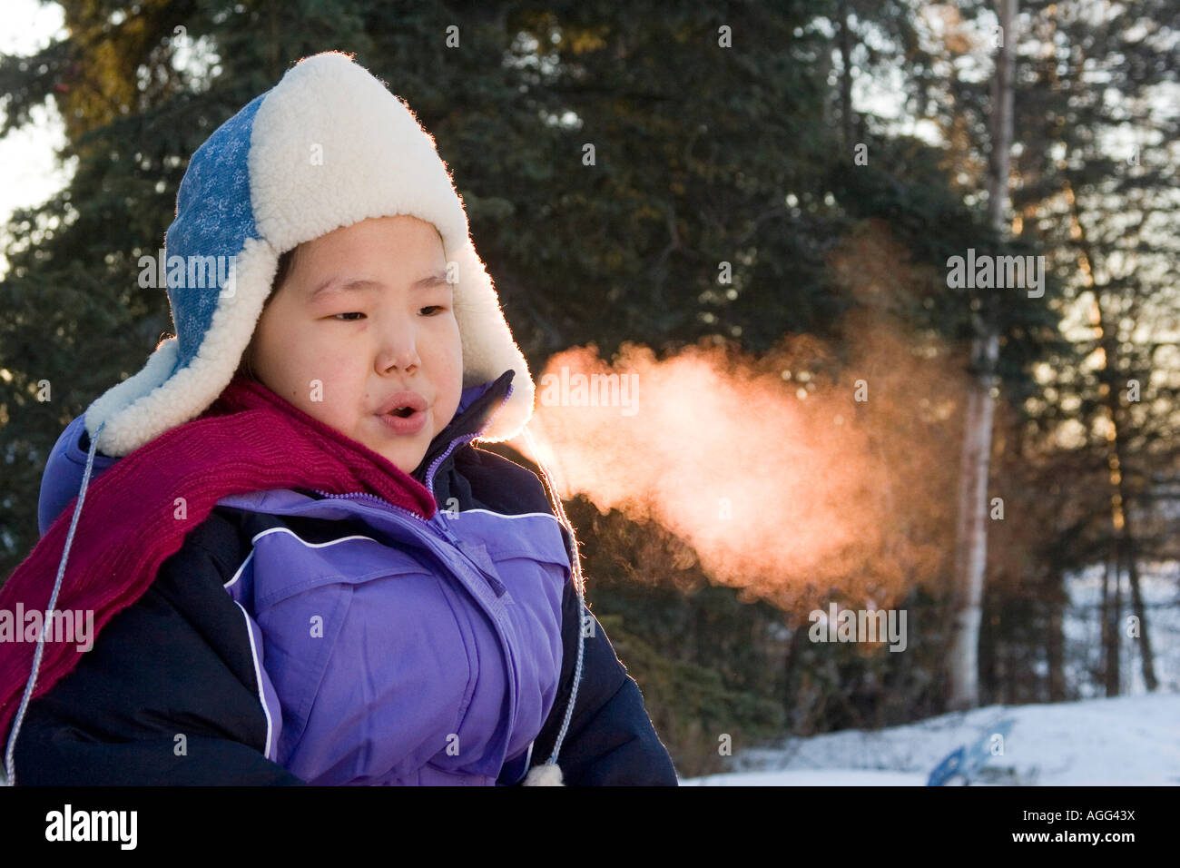Inuit Eskimo Girl on Chilly Morning Breath Visible AK Winter - Stock Image