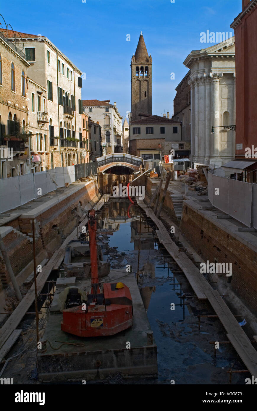 A drained canal undergoing repair in the Dorsoduro district of Venice Veneto Italy - Stock Image