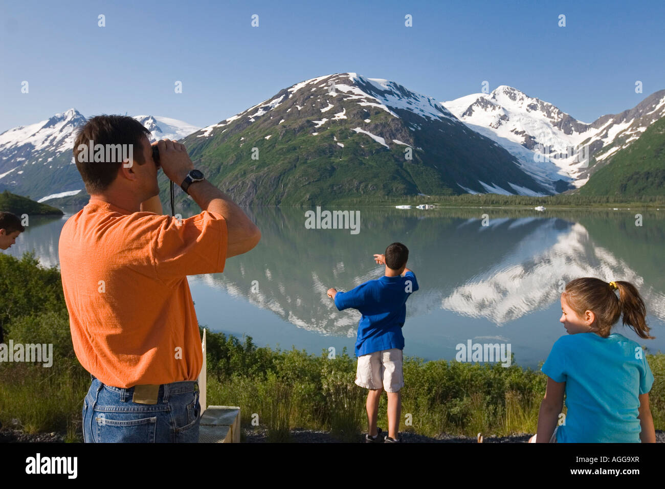 Family viewing scenery pull out for Portage Lake Kenai Mtns Southcentral Alaska Summer - Stock Image