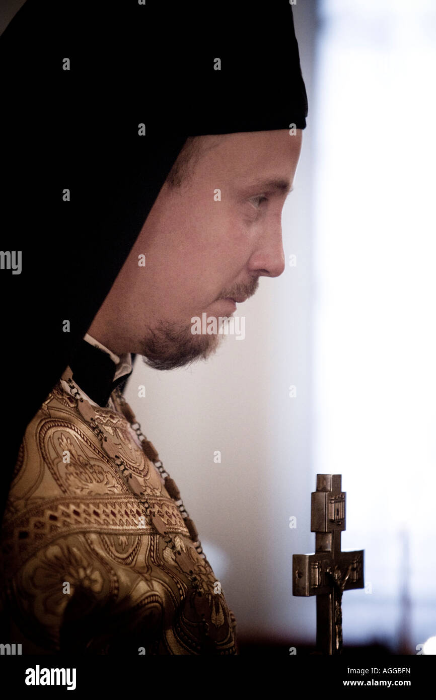 A russian orthodox priest in a church in Oslo, Norway - Stock Image