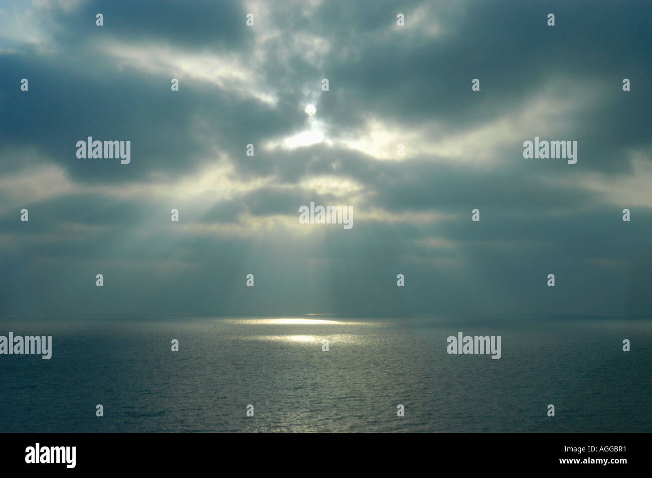 sunrays through clouds at sea, Sweden - Stock Image