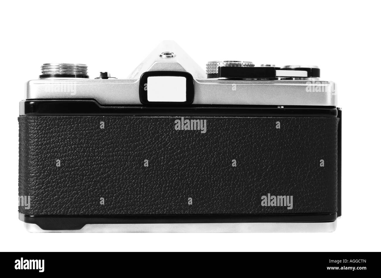 An old classic vintage 35mm camera shown in black and white from the back with film door closed - Stock Image