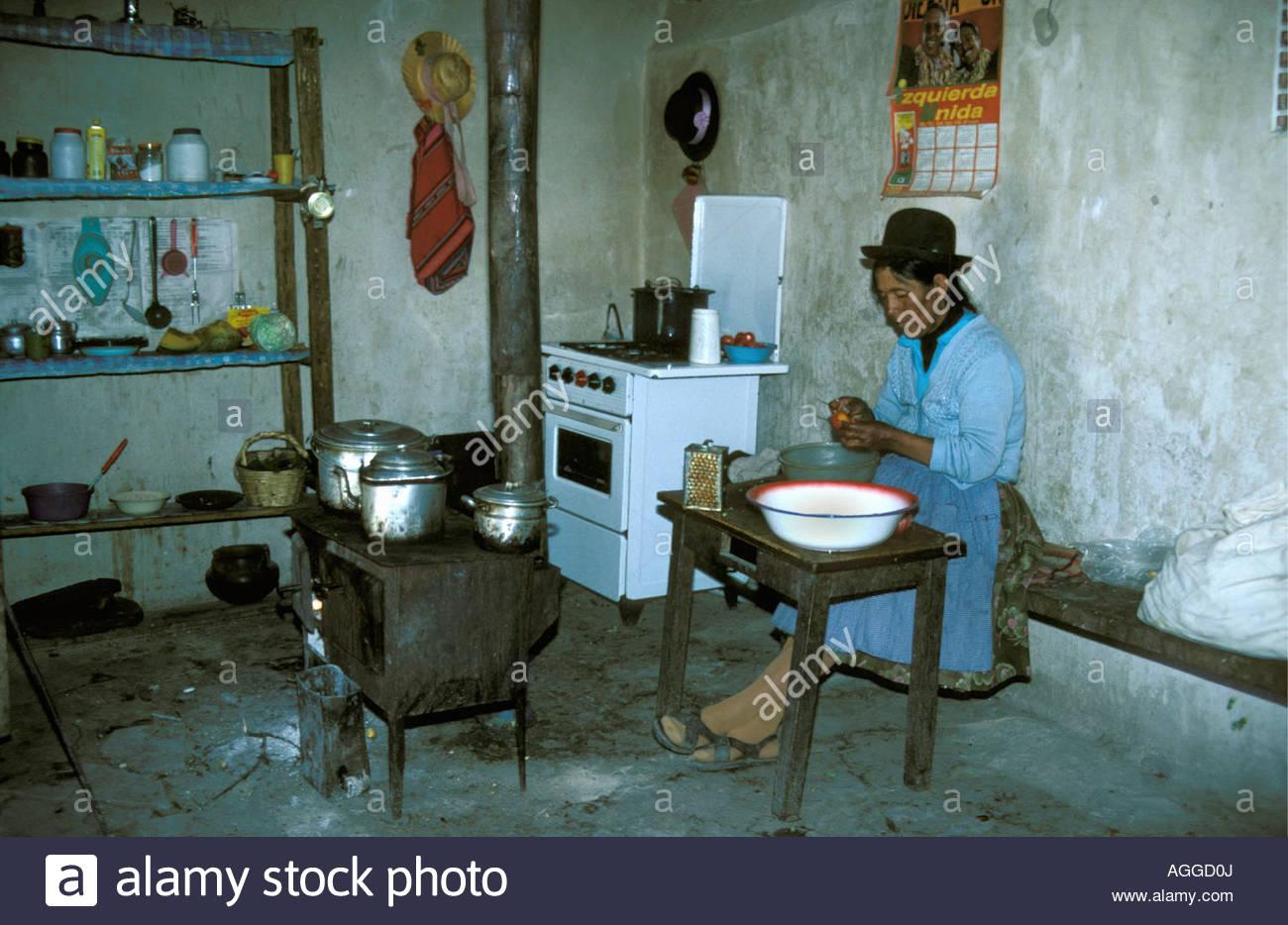 Bolivia, Uyuni, Aymara woman preparing food in kitchen Stock Photo ...