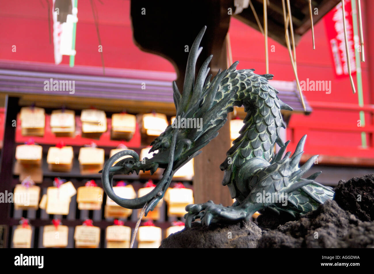 statue of dragon with a running water tap, Tokyo, Japan - Stock Image