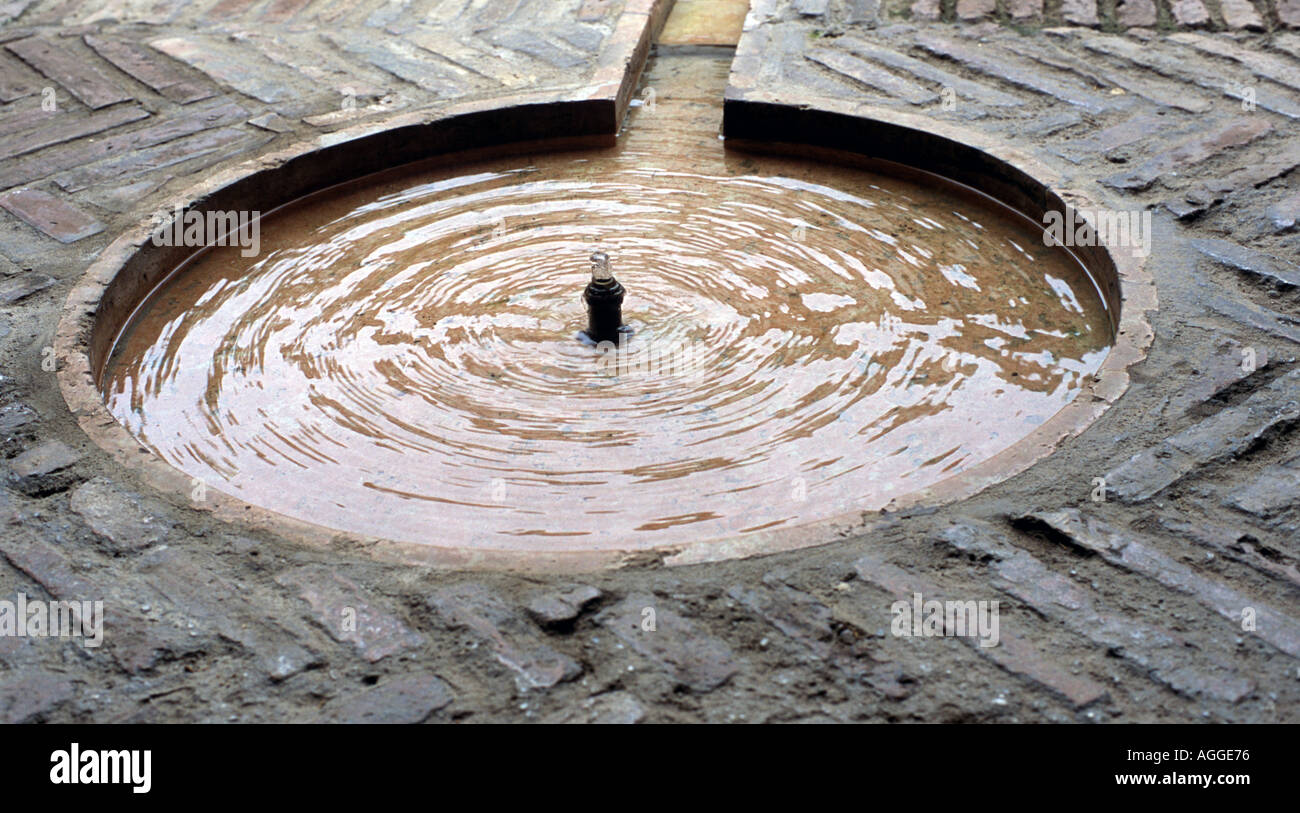 circular ripples produced by running water in alcazar Stock Photo