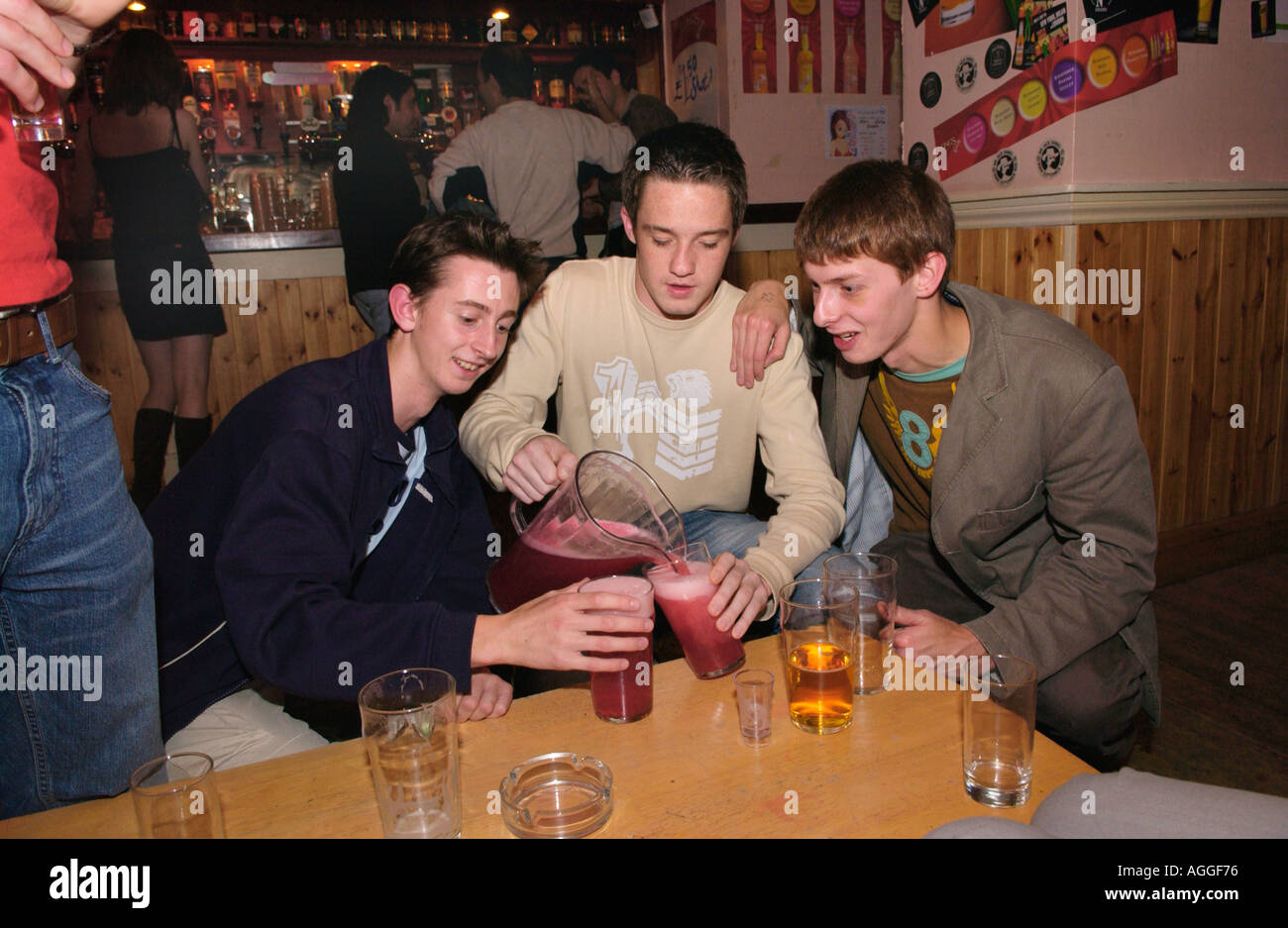 Students at Aberystwyth University drinking jugs of lager at The Glengower club in the town Ceredigion West Wales UK - Stock Image
