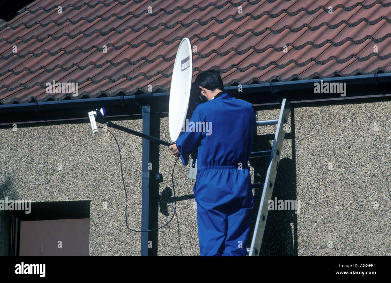 satellite dish being installed Stock Photo