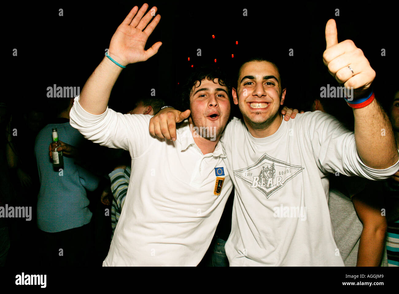 Two mates having a night out at Club Zoo in Warsaw Poland Stock Photo