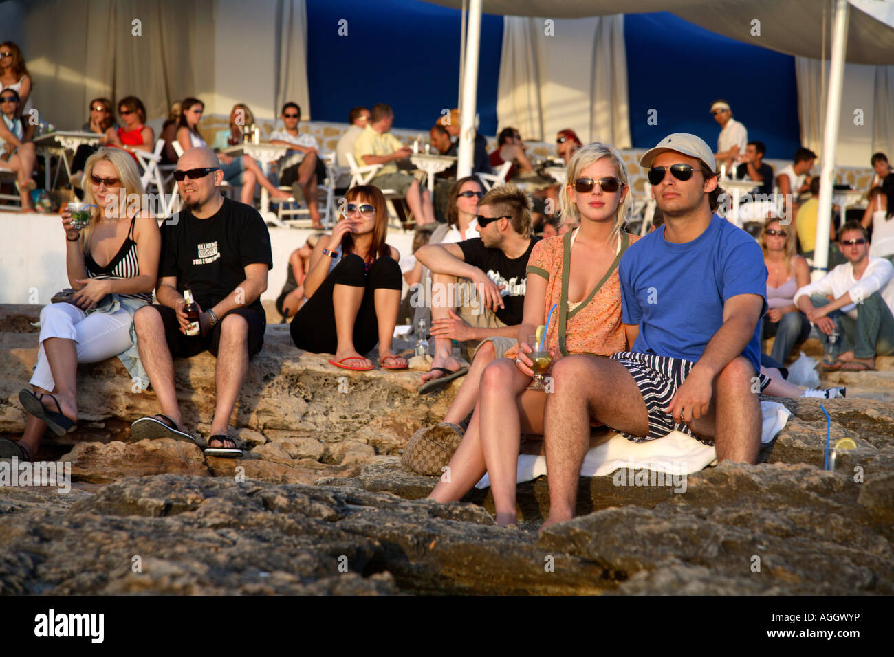 Tourists at Cafe del Mar, Ibiza, Spain - Stock Image