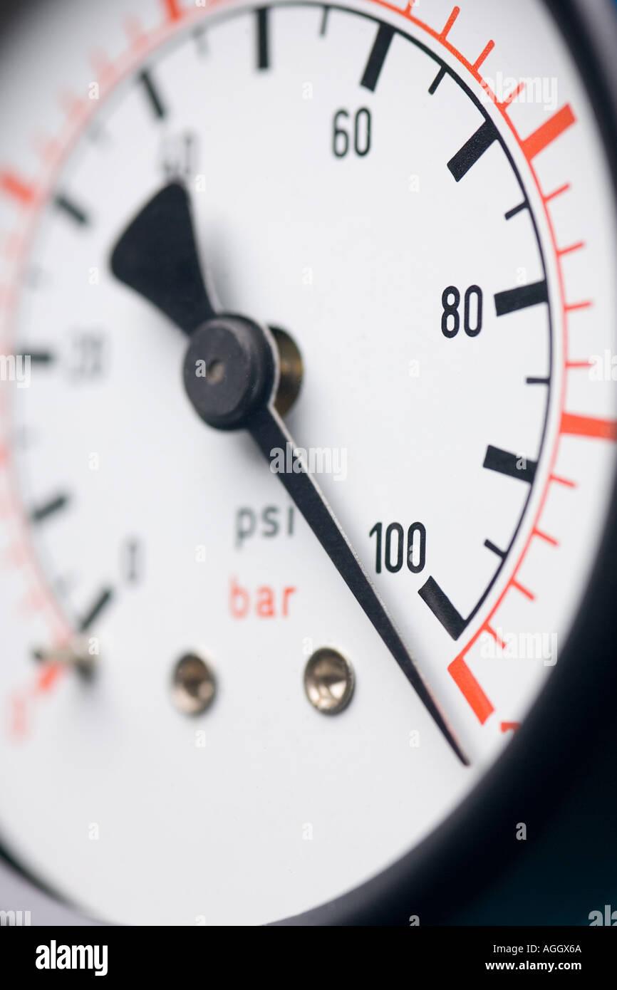 a pressure gauge showing high pressure - Stock Image