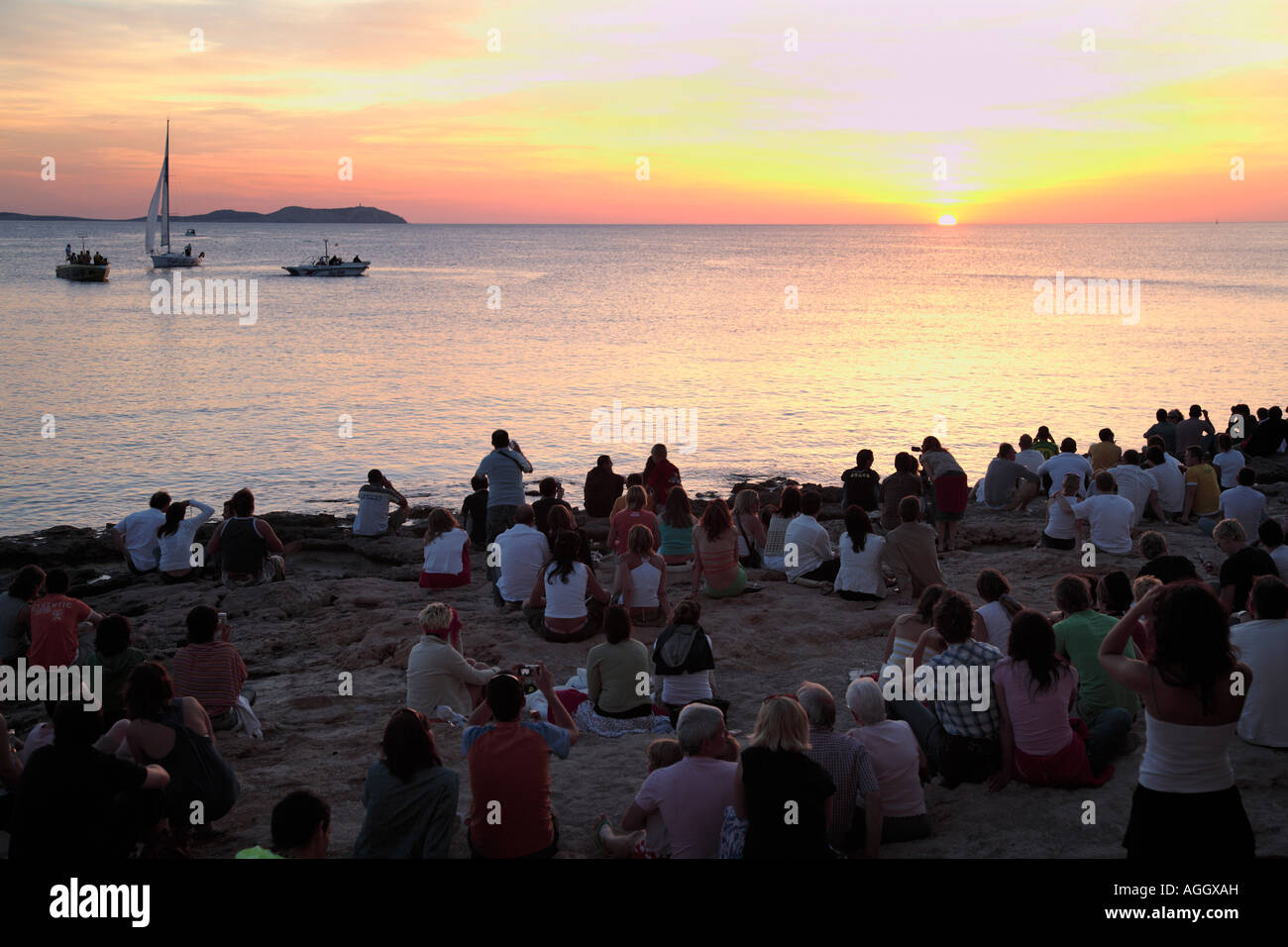 Tourists at Cafe del Mar, watching the sunset, Ibiza, Spain - Stock Image