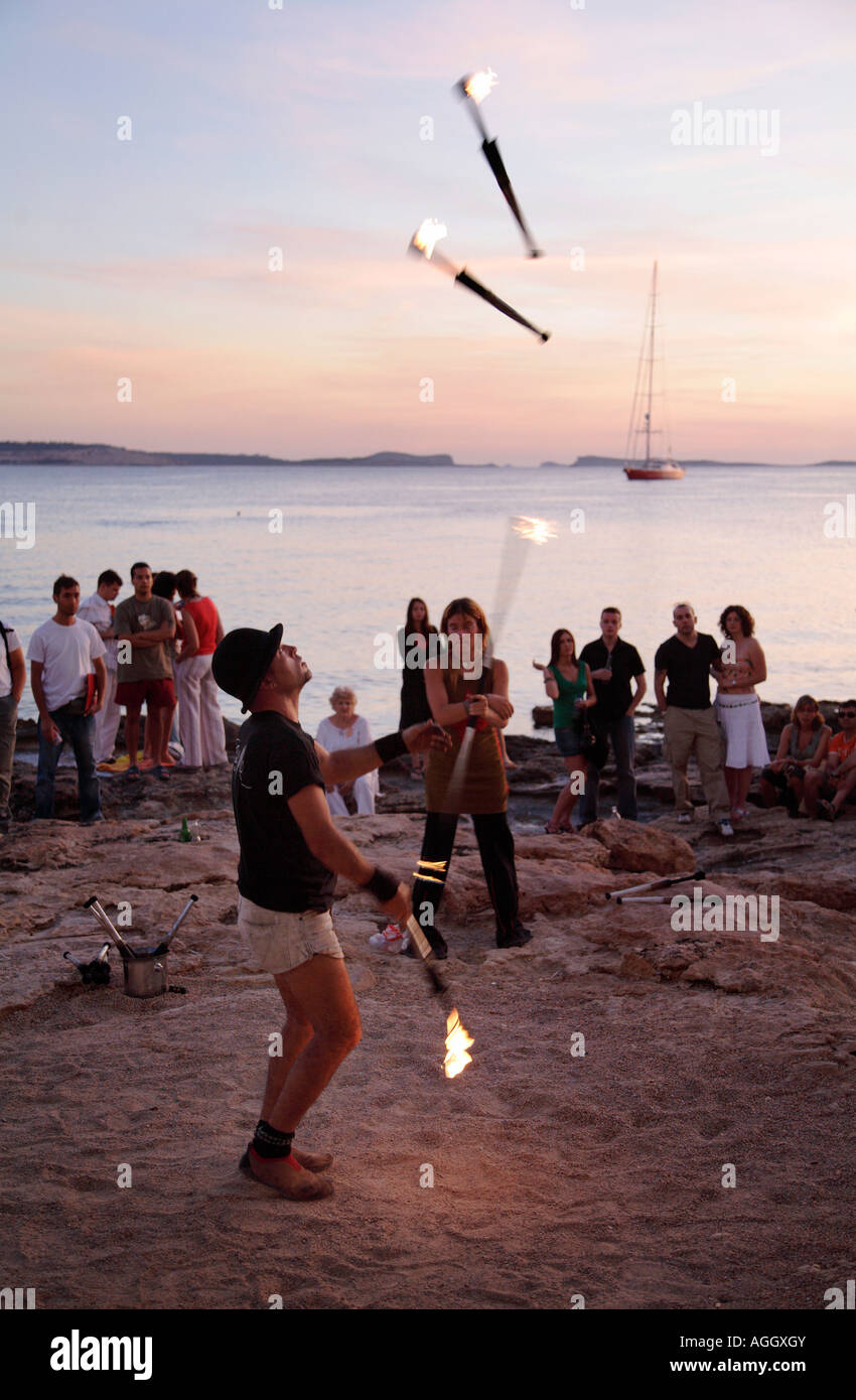 A juggler performing for the tourists at Cafe del Mar, Ibiza, Spain - Stock Image