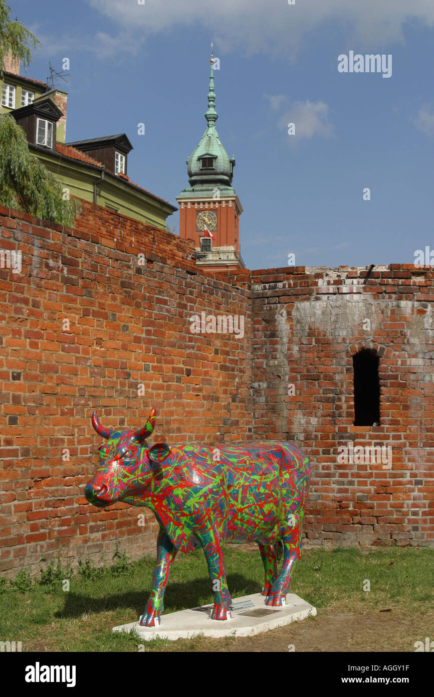 Warsaw Old Town Poland Modern Art Cow stands alongside the old town walls taken Summer 2005 - Stock Image