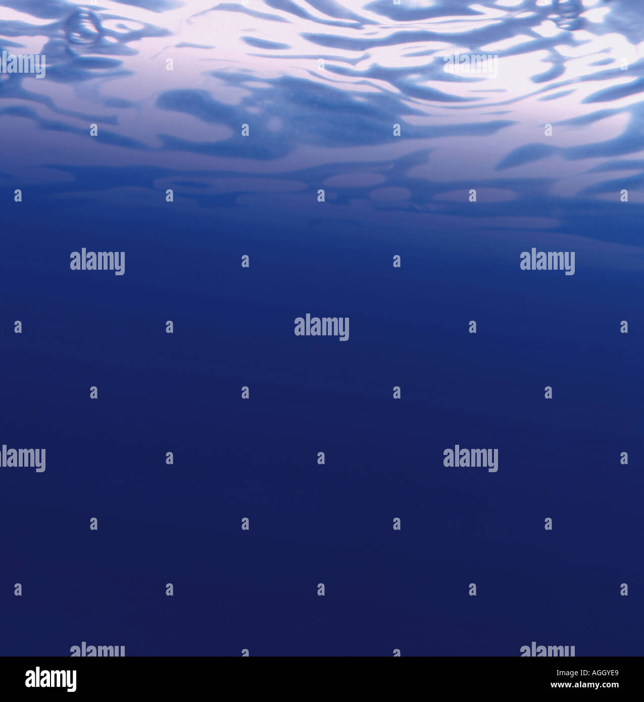 Under water view of sunlit surface - Stock Image