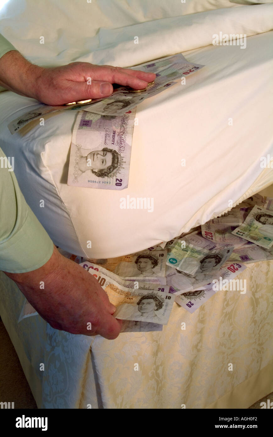 Bank Notes Under Bed Mattress With Hand Sorting Pound Sterling Cash Stock Photo Alamy