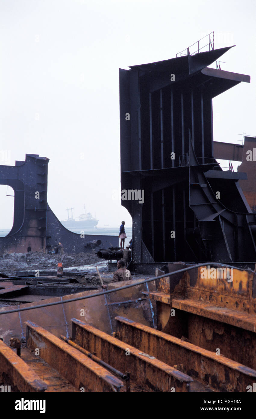 Bangladesh ship breaking yard (Chittagong). Ship recycling yard with industrial workers, heavy metal dismantling. Little health and safety observed. - Stock Image