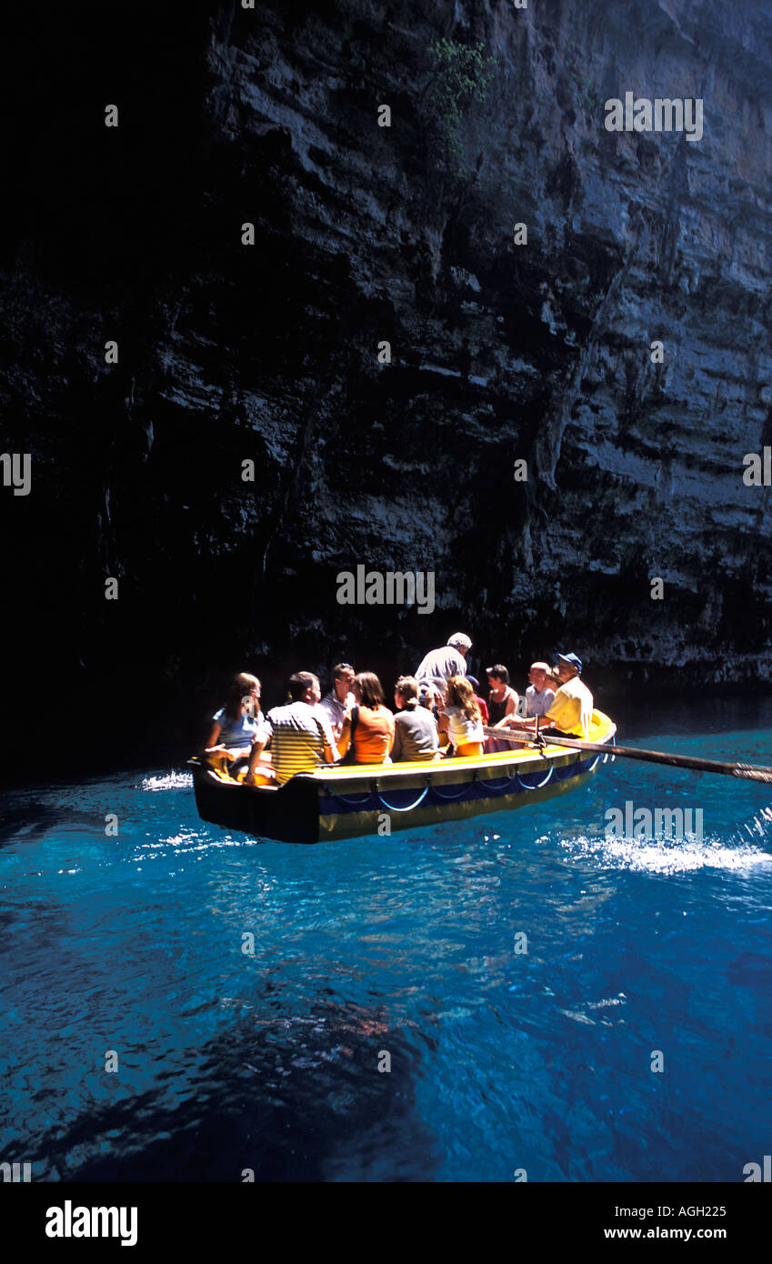 Tourists embark on a quick boat tour of Melissani Lake and cave underground lake Kefalonia Ionian Islands Greece - Stock Image