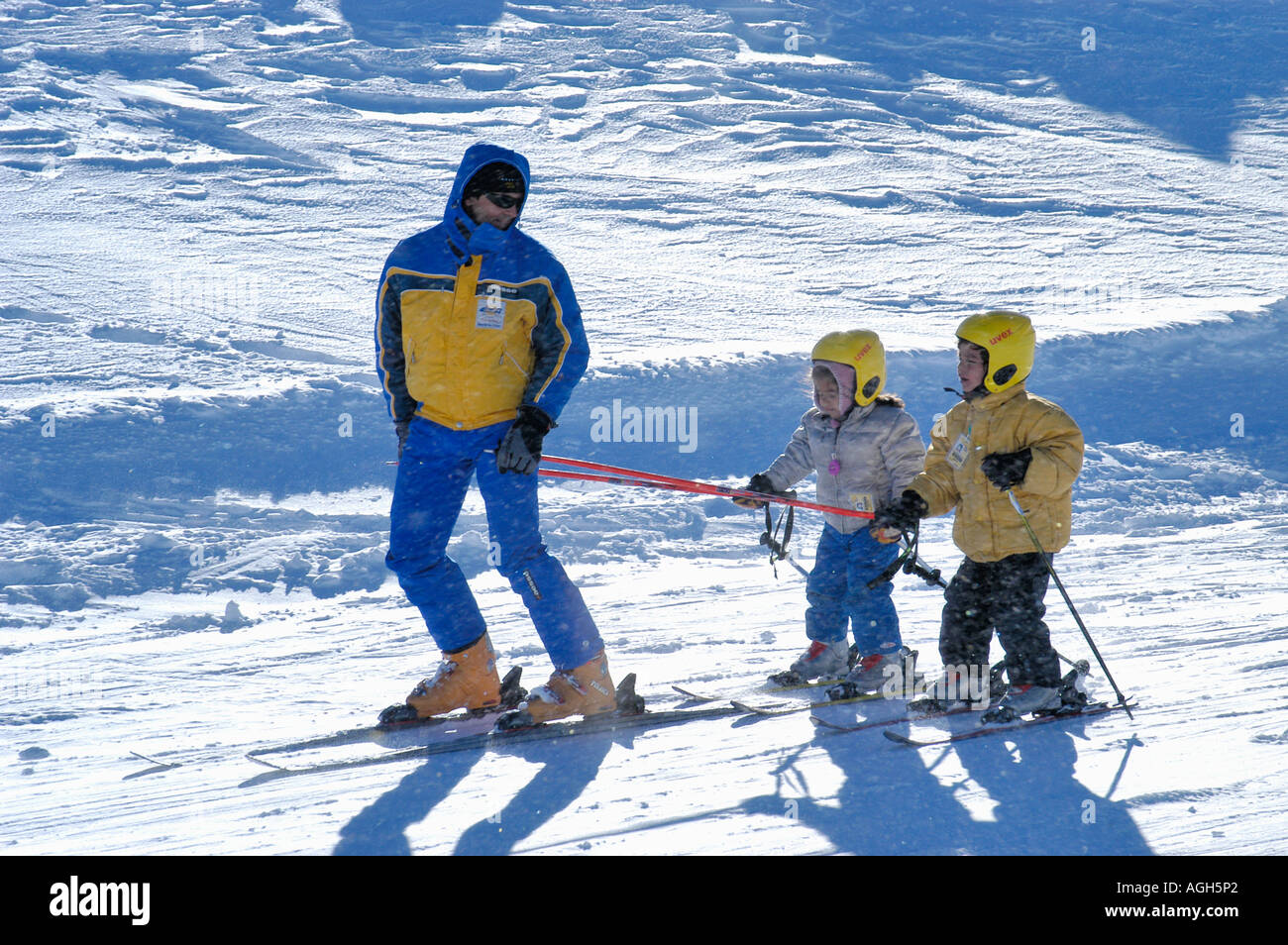 ski instructor with children, Val Thorens, French Alps, France - Stock Image