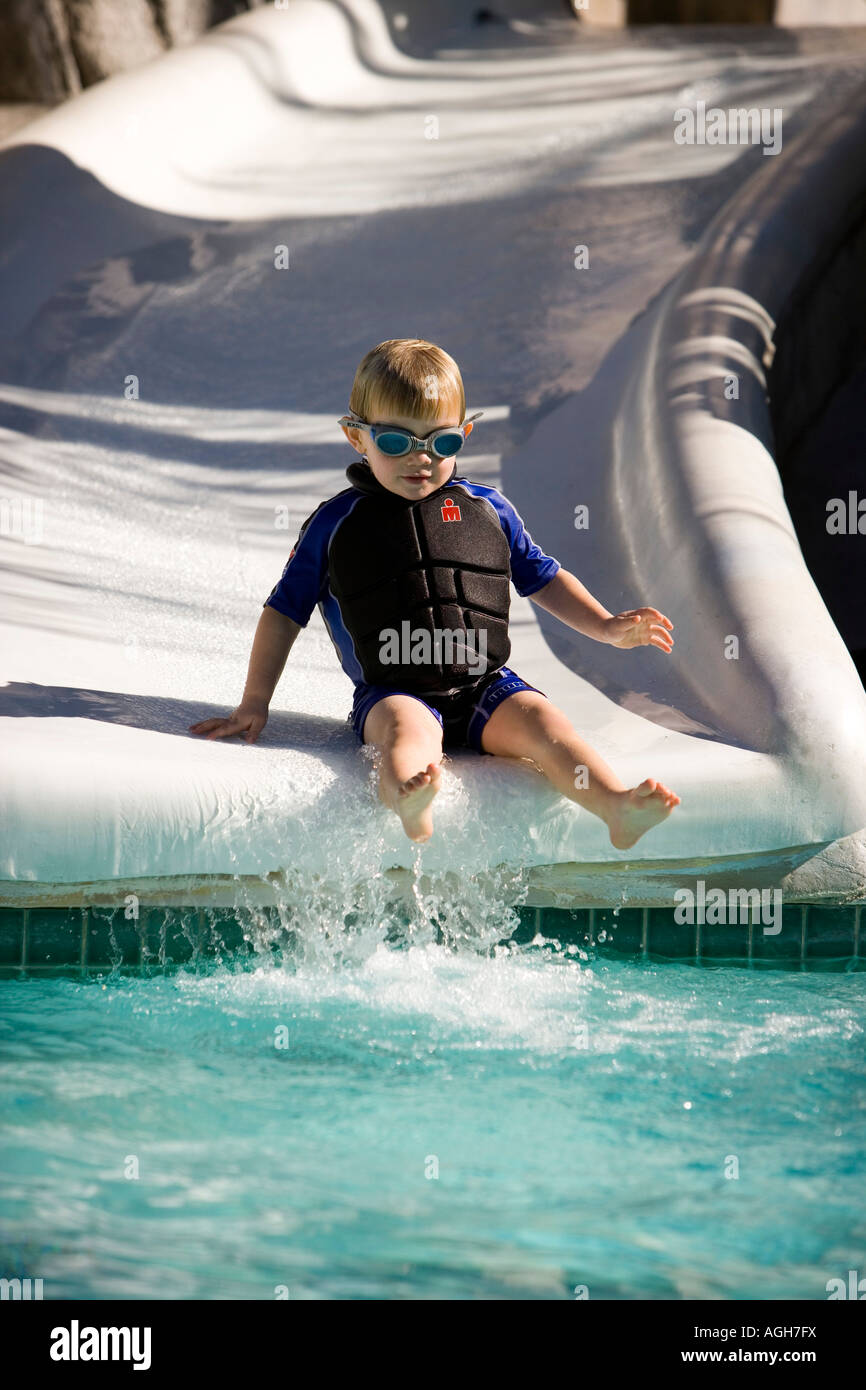 Boy on a water slide Palm Springs California - Stock Image