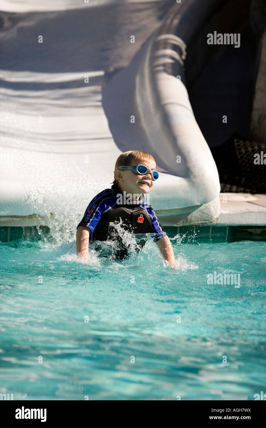 Boy on a water slide Palm Springs California USA - Stock Image