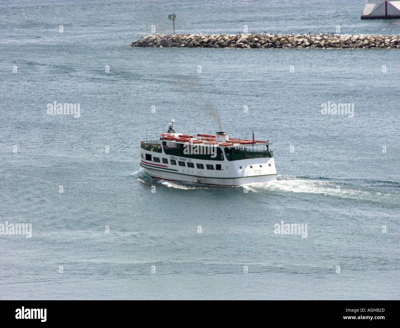 High seed boats transports tourists to Mackinaw mackinac Island in Michigan between the Upper and Lower Peninsula in Lake Huron - Stock Image