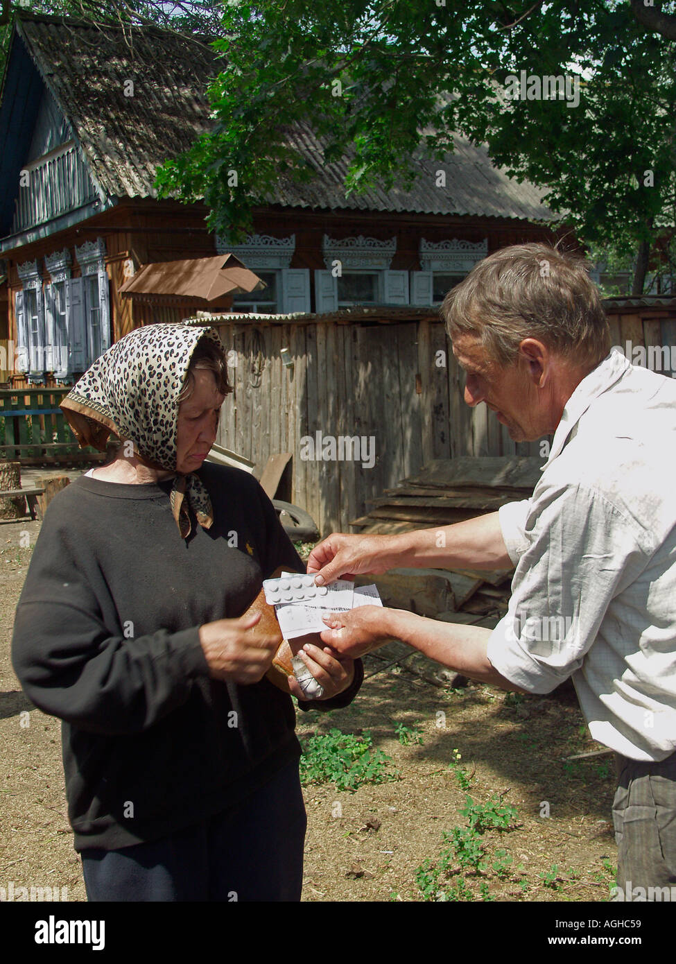 Chernobyl survivor, a Samosely woman buying proprietary pharmaceutical medicines outdoors in Chernobyl exclusion zone, Belarus Ukraine state border - Stock Image