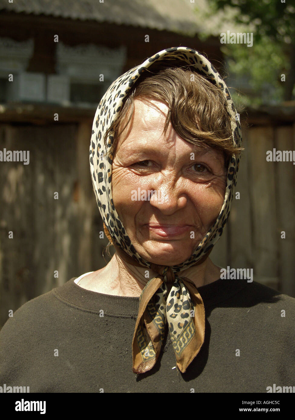 Portait of woman wearing headscarf, she is Samosely, a Chernobyl survivor aged 58, Chernobyl exclusion zone near Belarus Ukraine border - Stock Image