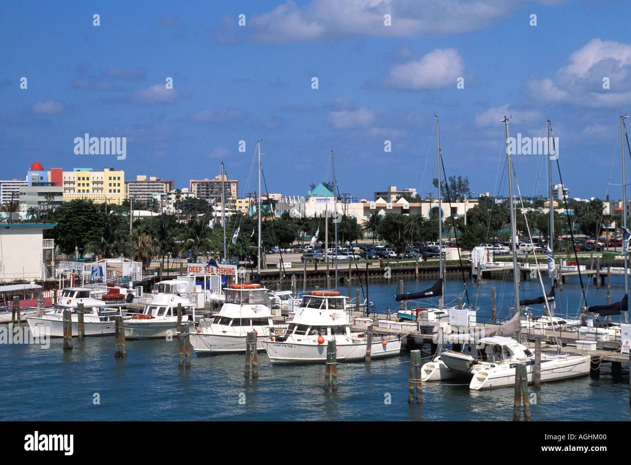 Miami Florida FL South Beach marina with boats at dock skyline behind - Stock Image