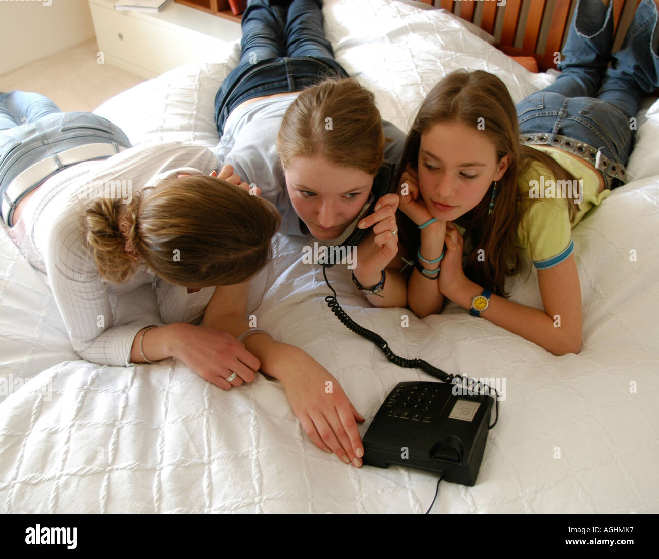 Teenage girls with telephone elevated view Stock Photo
