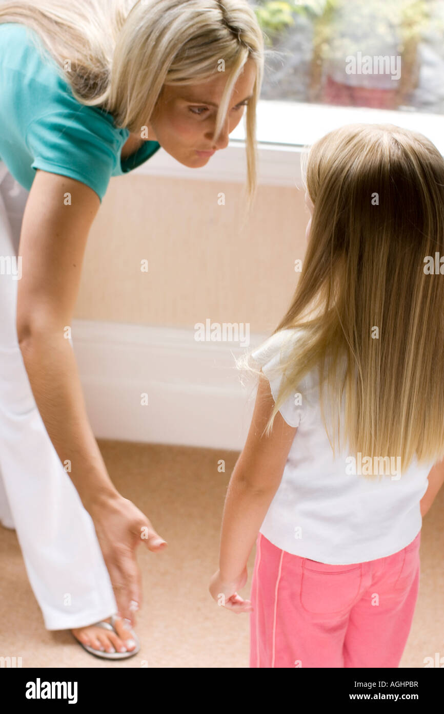 mother about to smack her daughter - Stock Image