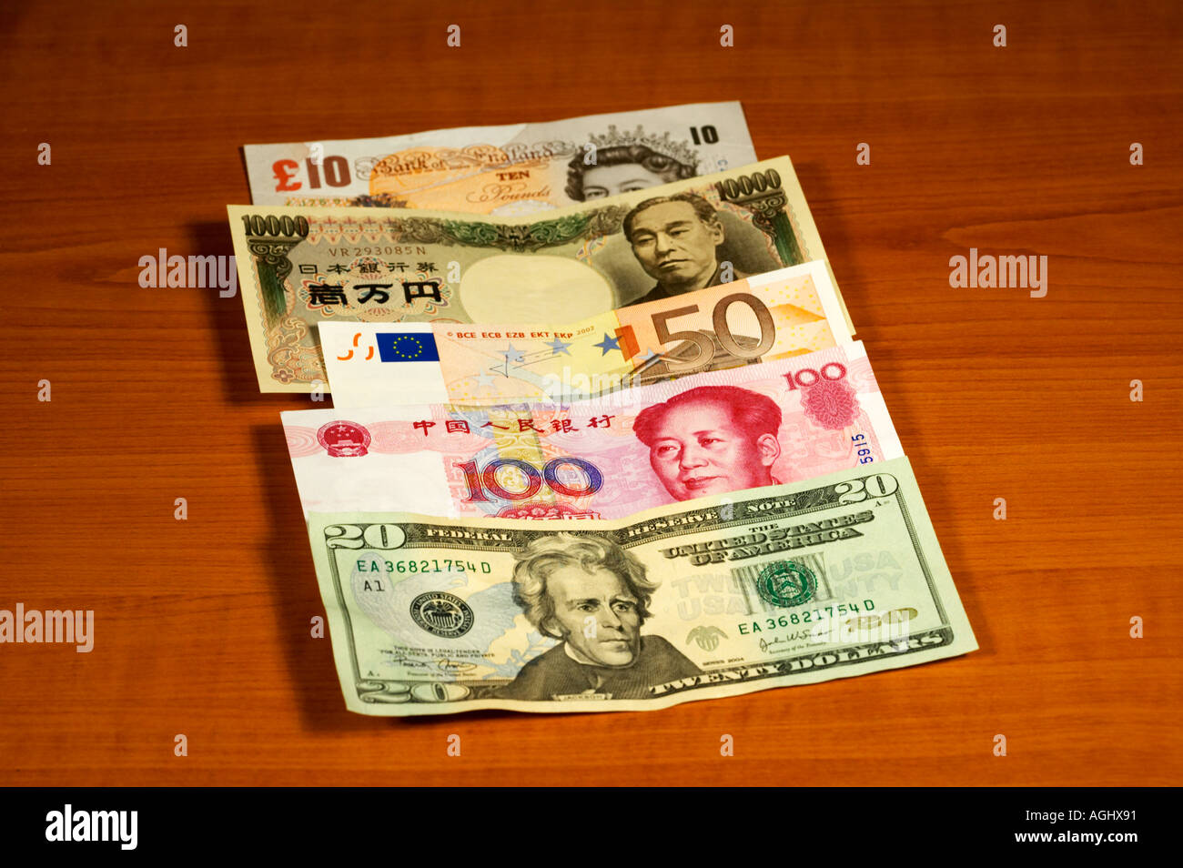 International World Currency spread on table US Dollar Chinese Yuan Euro Japanese Yen UK Sterling Pounds - Stock Image