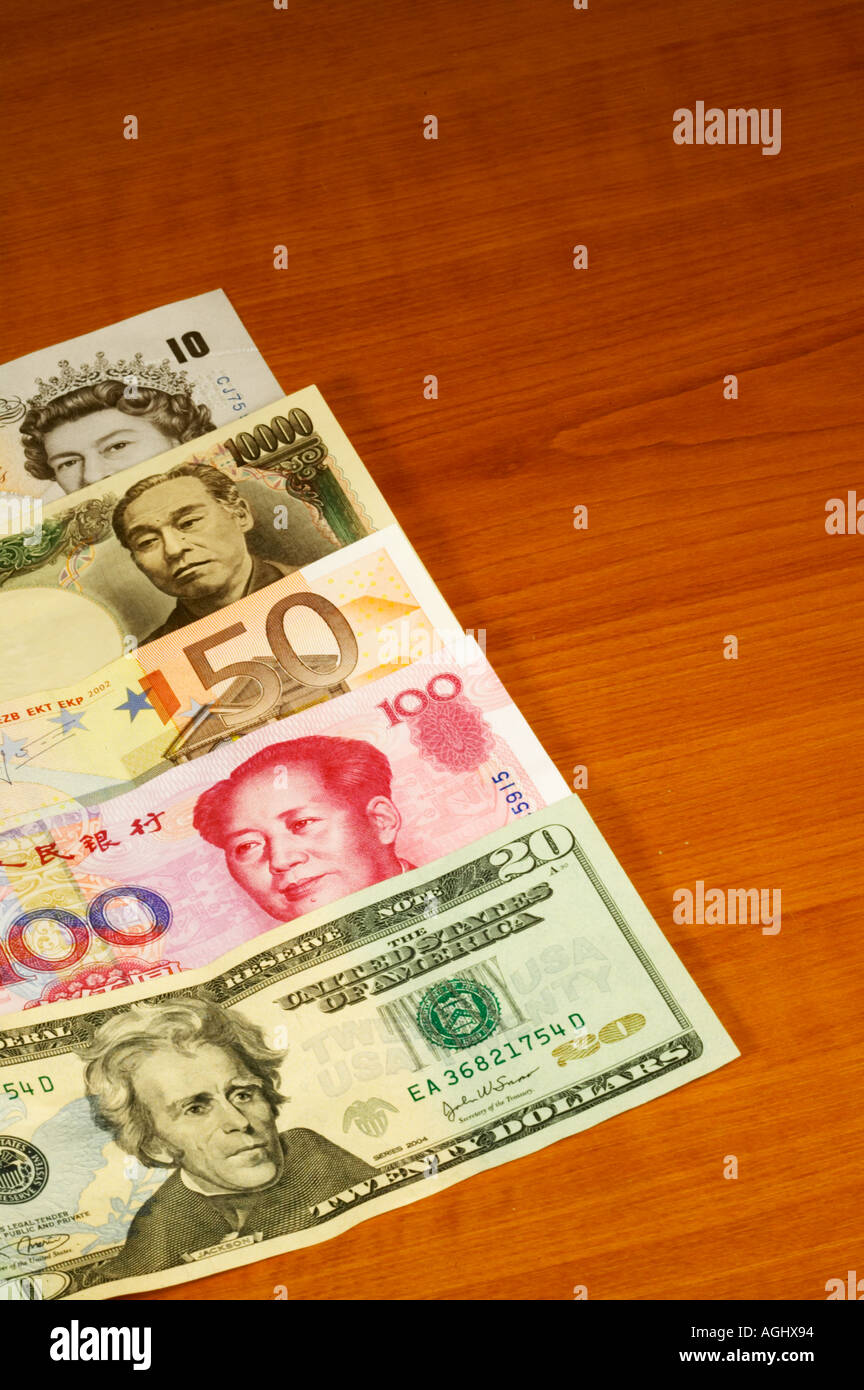 US Dollar Chinese Yuan Euro Japanese Yen UK Sterling Pounds spread on table - Stock Image