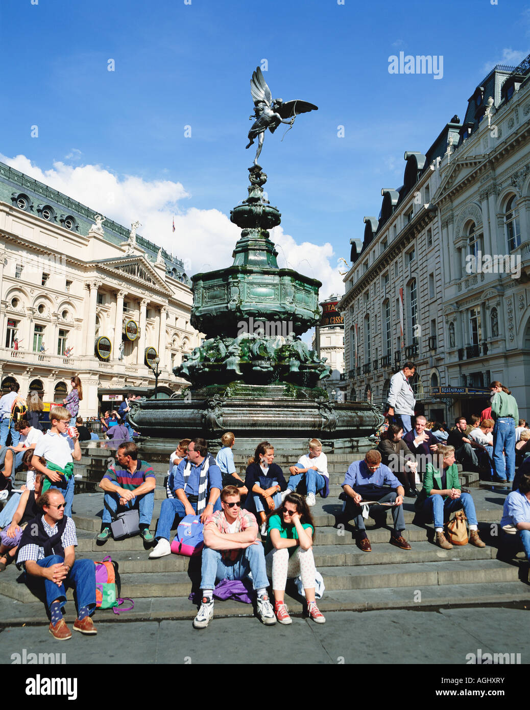 Tourists on steps of the Statue of Eros Piccadilly Circus London England UK GB - Stock Image