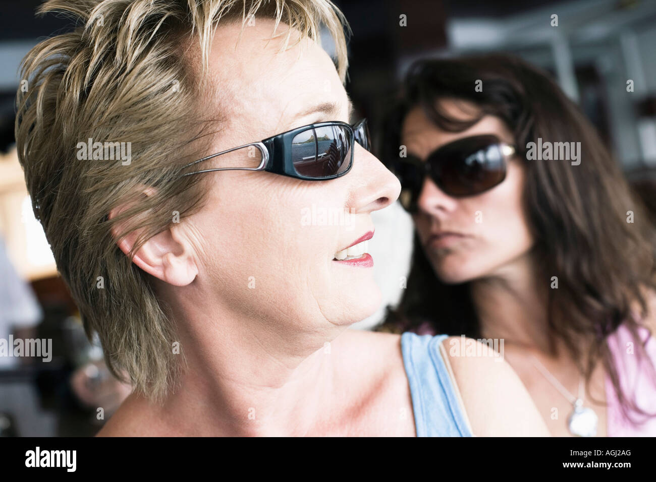 Close-up of a mature woman and a mid adult woman wearing sunglasses - Stock Image