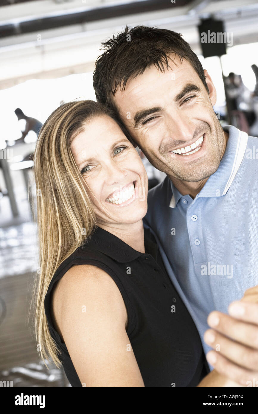 Portrait of a mid adult couple dancing in a nightclub and smiling - Stock Image