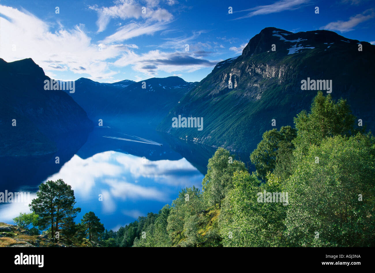 a boat cruising down Geraingerfjiord Norway - Stock Image