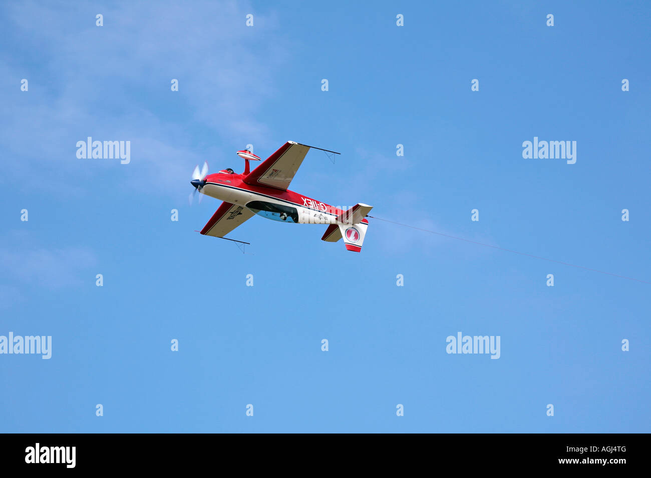 Extra 300L towplane with tow hook attached, performing aerial manoeuvre at Shoreham airshow, Shoreham airport, West Stock Photo