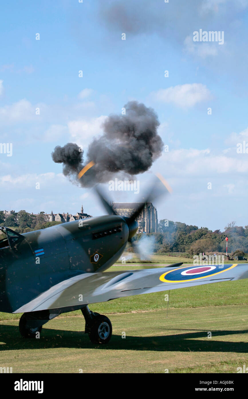 Spitfire waiting to take off during pyrotechnic display at Shoreham Aishow - Stock Image