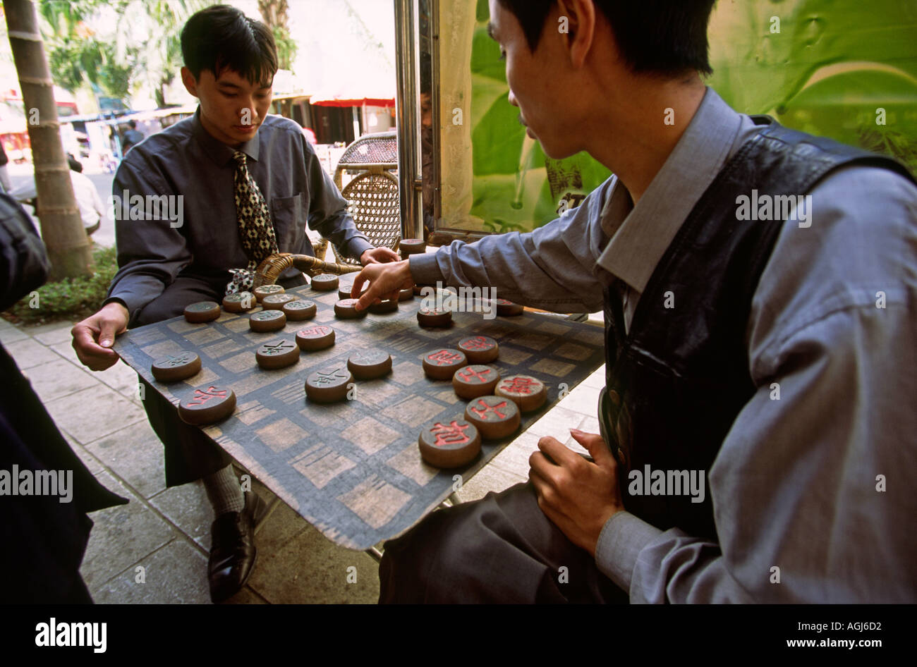 China Yunnan pastimes Jinghong men playing xiangqi Chinese chess - Stock Image