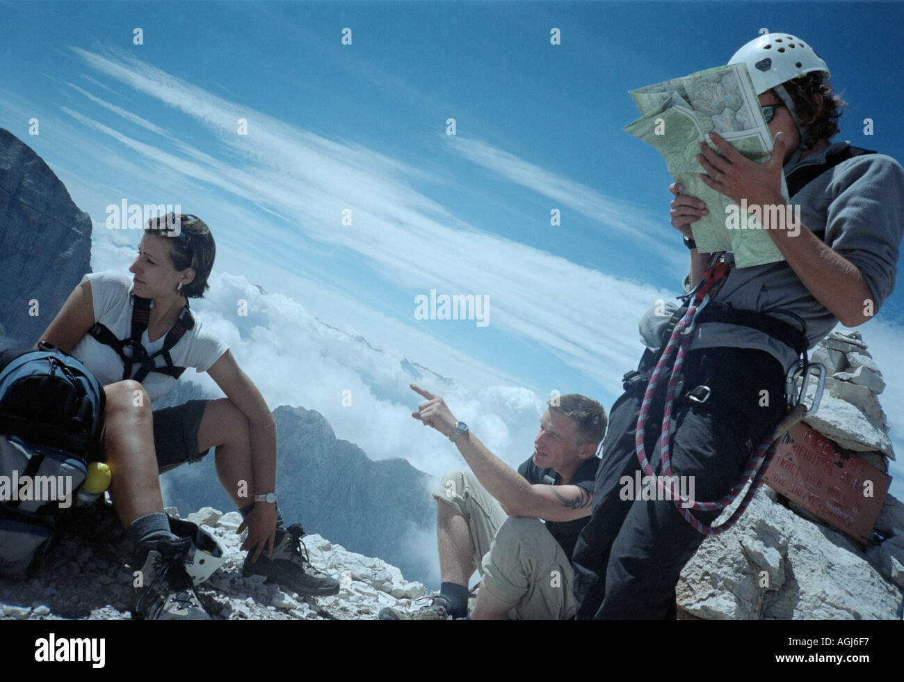 Italy Alps Dolomiti mountains young hikers having a rest after a long climb - Stock Image
